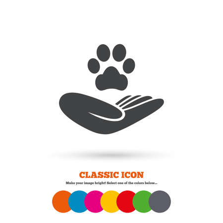 animal shelter: Shelter pets sign icon. Hand holds paw symbol. Animal protection. Classic flat icon. Colored circles. Vector Illustration