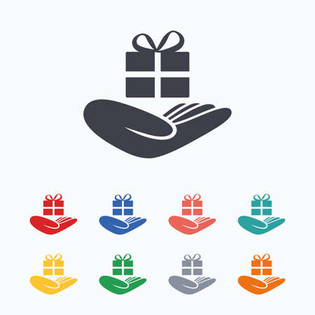 give a gift: Give a gift sign icon. Hand holds present box with bow. Colored flat icons on white background.