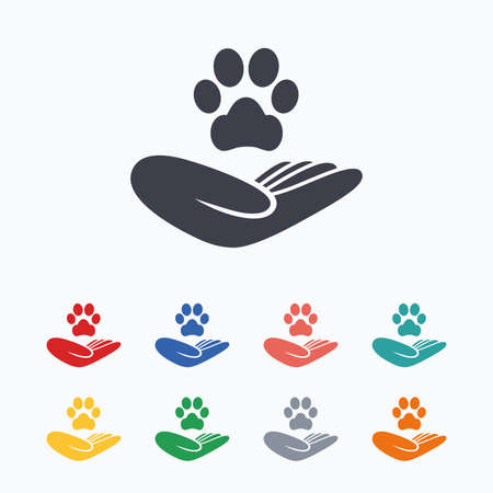 Shelter pets sign icon. Hand holds paw symbol. Animal protection. Colored flat icons on white background.