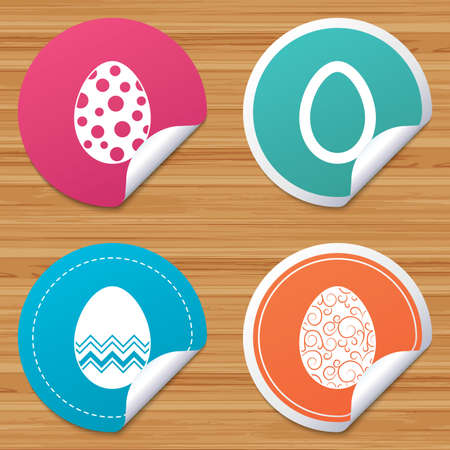 bended: Round stickers or website banners. Easter eggs icons. Circles and floral patterns symbols. Tradition Pasch signs. Circle badges with bended corner. Vector