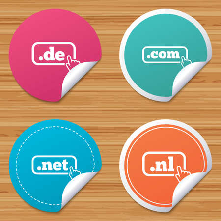 Round stickers or website banners. Top-level internet domain icons. De, Com, Net and Nl symbols with hand pointer. Unique national DNS names. Circle badges with bended corner. Vector Vektoros illusztráció