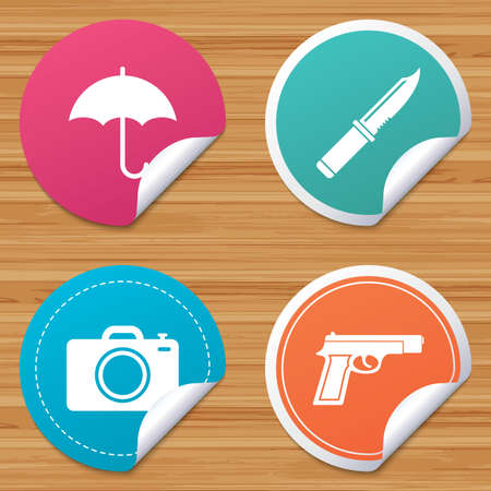 edged: Round stickers or website banners. Gun weapon icon.Knife, umbrella and photo camera signs. Edged hunting equipment. Prohibition objects. Circle badges with bended corner. Vector Illustration