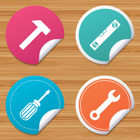 bended: Round stickers or website banners. Screwdriver and wrench key tool icons. Bubble level and hammer sign symbols. Circle badges with bended corner. Vector