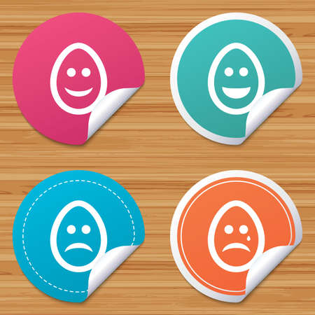 Round stickers or website banners. Eggs happy and sad faces icons. Crying smiley with tear symbols. Tradition Easter Pasch signs. Circle badges with bended corner. Vector