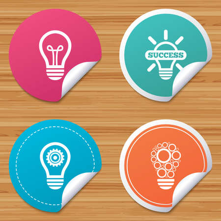bended: Round stickers or website banners. Light lamp icons. Circles lamp bulb symbols. Energy saving with cogwheel gear. Idea and success sign. Circle badges with bended corner. Vector Illustration