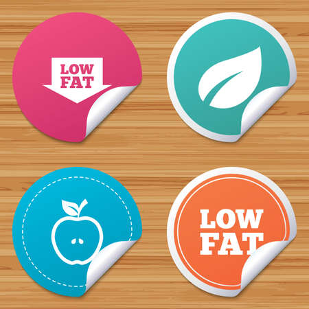 lowfat: Round stickers or website banners. Low fat arrow icons. Diets and vegetarian food signs. Apple with leaf symbol. Circle badges with bended corner. Vector