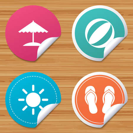 Round stickers or website banners. Beach holidays icons. Ball, umbrella and flip-flops sandals signs. Summer sun symbol. Circle badges with bended corner. Vector