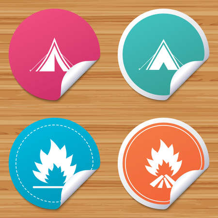 Round stickers or website banners. Tourist camping tent icons. Fire flame sign symbols. Circle badges with bended corner. Vector Illustration