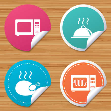 bended: Round stickers or website banners. Microwave grill oven icons. Cooking chicken signs. Food platter serving symbol. Circle badges with bended corner. Vector