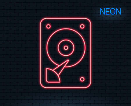 Neon light. HDD icon. Hard disk storage sign. Hard drive memory symbol. Glowing graphic design. Brick wall. Vector