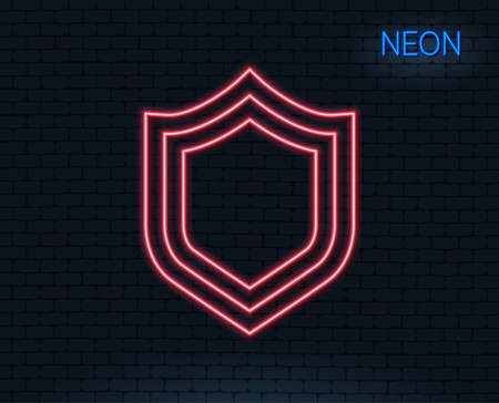 Neon light. Shield line icon. Protection or Security sign. Defence or Guard symbol. Glowing graphic design. Brick wall. Vector