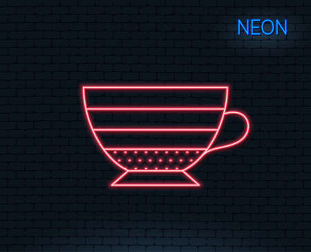 Neon light. Cappuccino coffee icon. Hot drink sign. Beverage symbol. Glowing graphic design. Brick wall.