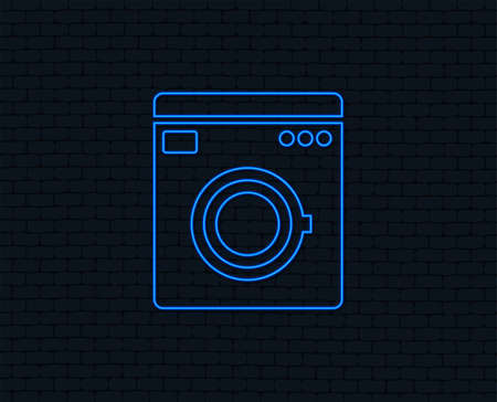 Neon light. Washing machine icon. Home appliances symbol. Glowing graphic design. Brick wall. Vector illustration.