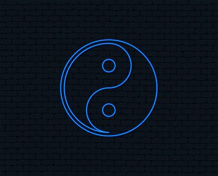 Neon light. Yin yang sign icon. Harmony and balance symbol. Glowing graphic design. Brick wall. Vector illustration.