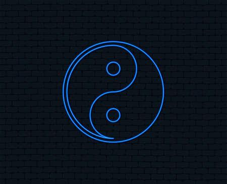 Neon light. Yin yang sign icon. Harmony and balance symbol. Glowing graphic design. Brick wall. Vector illustration.