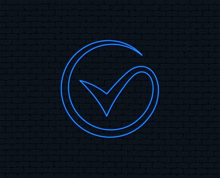 Neon light. Tick sign icon. Check mark symbol. Glowing graphic design. Brick wall. Vector