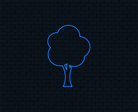Neon light. Tree sign icon. Forest symbol. Glowing graphic design. Brick wall. Vector