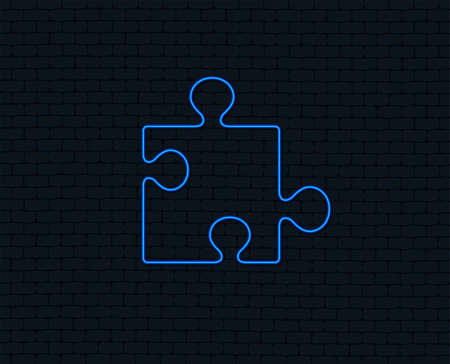 Neon light. Puzzle piece sign icon. Strategy symbol. Glowing graphic design. Brick wall. Vector illustration. Illustration