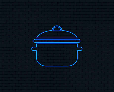 Neon light. Cooking pan sign icon. Boil or stew food symbol. Glowing graphic design. Brick wall. Vector Illustration