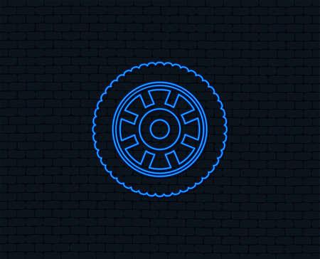 Neon light. Car wheel sign icon. Circular transport component symbol. Glowing graphic design. Brick wall. Vector Illustration