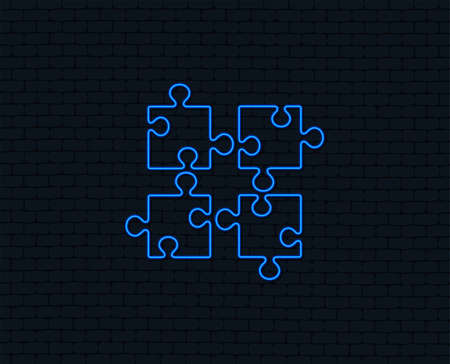Neon light. Puzzle pieces sign icon. Strategy symbol. Glowing graphic design. Brick wall. Vector