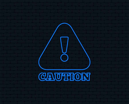 Neon light. Attention caution sign icon. Exclamation mark. Hazard warning symbol. Glowing graphic design. Brick wall. Vector