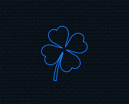 Neon light. Clover with four leaves sign icon. Saint Patrick symbol. Glowing graphic design. Brick wall. Vector