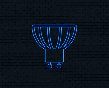 Neon light. Light bulb icon. Lamp GU10 socket symbol. Led or halogen light sign. Glowing graphic design. Brick wall. Vector Illustration