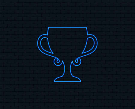 Neon light. Winner cup sign icon. Awarding of winners symbol. Trophy. Glowing graphic design. Brick wall. Vector Illustration