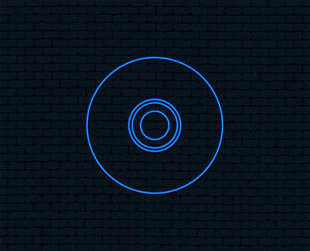 Neon light. CD or DVD sign icon. Compact disc symbol. Glowing graphic design. Brick wall.
