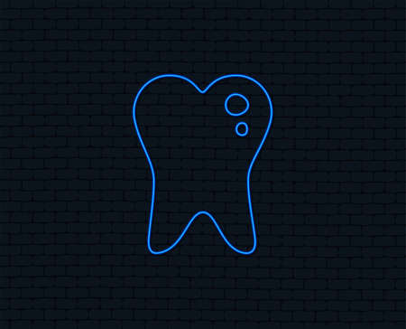 Neon light. Caries tooth icon. Tooth filling sign. Dental care symbol. Glowing graphic design. Brick wall.