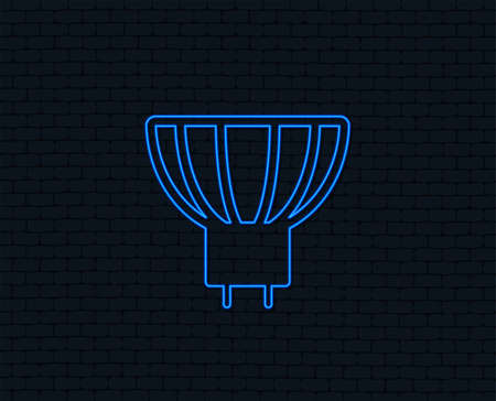 Neon light. Light bulb icon. Led or halogen light sign. Glowing graphic design. Brick wall.