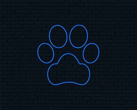 Neon light. Dog paw sign icon. Pets symbol. Glowing graphic design. Brick wall. Vector