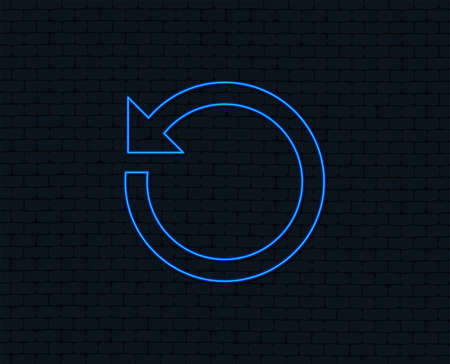 Neon light. Repeat icon. Refresh symbol. Loop sign. Glowing graphic design. Brick wall.
