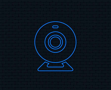 Neon light. Webcam sign icon. Web video chat symbol. Camera chat. Glowing graphic design. Brick wall.