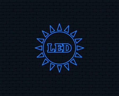 Neon light. Led light sun icon. Energy symbol. Glowing graphic design. Brick wall.