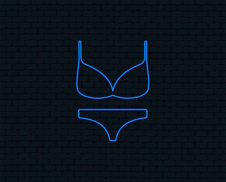 Neon light. Women bra and panties sign icon. Intimates underwear symbol. Glowing graphic design. Brick wall. Vector