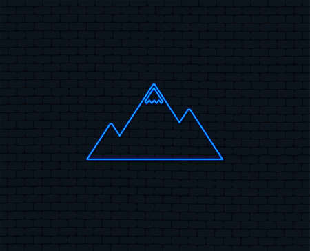 Neon light. Mountain icon. Mountaineering sport sign. Leadership motivation concept. Glowing graphic design. Brick wall. Vector Illustration