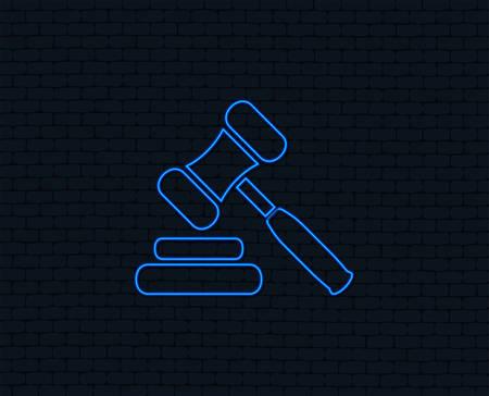 Neon light. Auction hammer icon. Law judge gavel symbol. Glowing graphic design. Brick wall. Vector