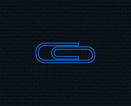 Neon light. Paper clip sign icon. Clip symbol. Glowing graphic design. Brick wall. Vector