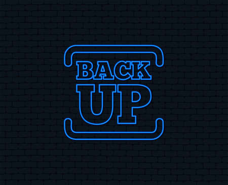 Neon light. Backup date sign icon. Storage symbol with arrow. Glowing graphic design. Brick wall. Vector Illustration