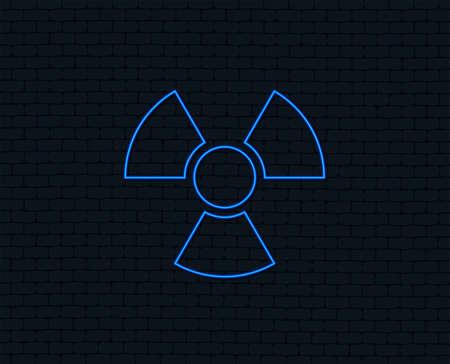Neon light. Radiation sign icon. Danger symbol. Glowing graphic design. Brick wall. Vector Illustration