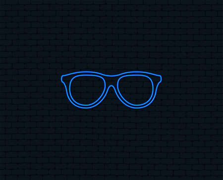 Neon light. Retro glasses sign icon. Eyeglass frame symbol. Glowing graphic design. Brick wall. Vector