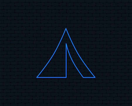 Neon light. Tourist tent sign icon. Camping symbol. Glowing graphic design. Brick wall. Vector