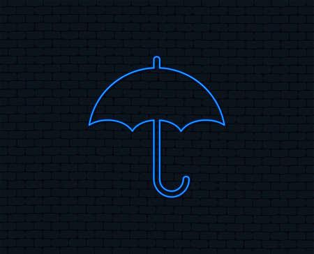 Neon light. Umbrella sign icon. Rain protection symbol. Glowing graphic design. Brick wall. Vector