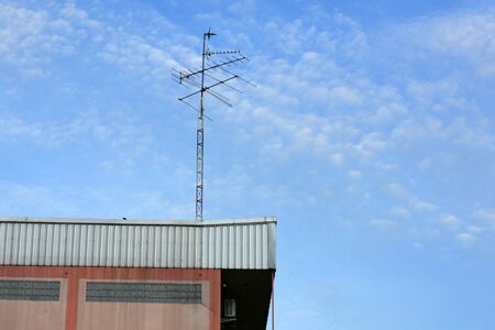 Old Home TV Antenna on top of building
