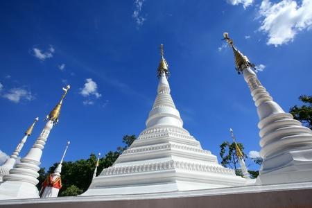Beautiful White Pagodas of Mon Architecture with nice sky Stock Photo
