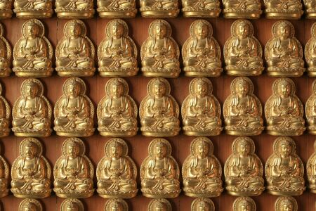 Gold Buddha sculptures on the wall inside Chinese temple Stock Photo - 10509969