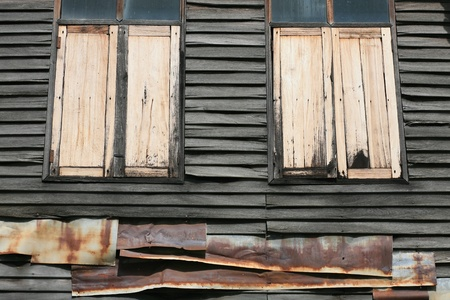 Wooden window and  wall with corrugated iron Stock Photo - 10510078