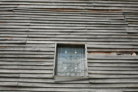Wooden Wall exterior and protection steel window photo